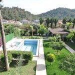 kemer-house-with-furniture-surrounded-by-greenery-001.jpg