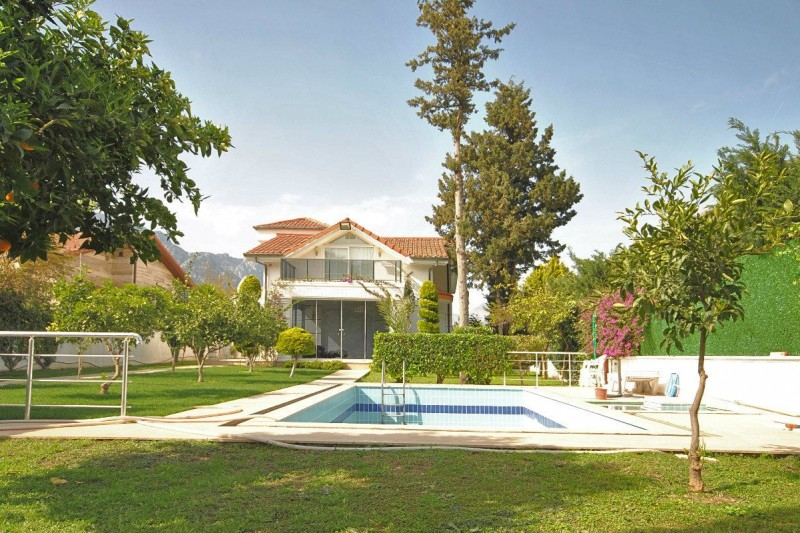 kemer-house-with-furniture-surrounded-by-greenery-main.jpg